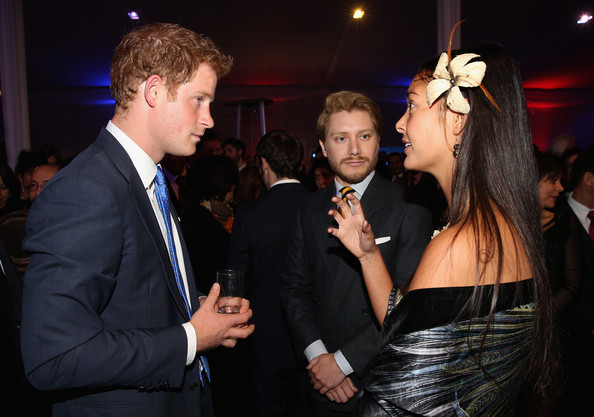Prince Harry chats to guests at a Queen's Birthday Party event at the British Ambassador's Residence on June 27, 2014 in Santiago, Chile.  Prince Harry is on a three day tour of Chile after visiting Brazil.