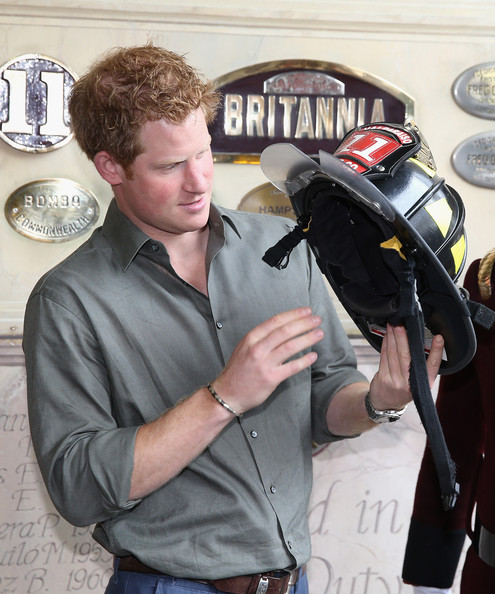 Prince Harry puts on a fireman's hat at Valpariso Firestation on June 28, 2014 in Valpariso, Chile. Firefighters from Valpariso were involved in dealing with the devastating forest fires that hit the area in April. Prince Harry is on a three day tour of Chile after visiting Brazil.