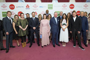 Prince Charles, Prince of Wales poses for a photograph with Celebrity Trust Ambassadors Cheryl, Olivia Coleman, Tom Hardy, Helen McCory, Olly Murs, Tom Jones, Tom Fletcher, Giovanna Fletcher, Melanie Chisholm, Caroline Flack, Phillip Schofield, Laura Whitmore, Kate Garraway, Bryan Cranston, Aston Merrygold, and Naughty Boy at The Prince's Trust Awards at The London Palladium on March 6, 2018 in London, England.
