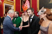 Prince Charles, Prince of Wales meets guests as Douglas Booth (second right) smiles at a reception hosted by the Prince and Camilla, Duchess of Cornwall for the Elephant Family Animal Ball at Clarence House on June 13, 2019 in London, England. Elephant Family is an international NGO dedicated to protecting the Asian elephant from extinction in the wild.