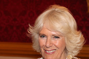 Camilla, Duchess of Cornwall holds a face mask and smiles as she and Prince Charles, Prince of Wales host a reception for the Elephant Family Animal Ball at Clarence House on June 13, 2019 in London, England. Elephant Family is an international NGO dedicated to protecting the Asian elephant from extinction in the wild.