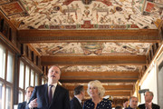Camilla, Duchess Of Cornwall is shown around by Dr Eike Schmidt (L) director of the Uffuzi Gallery, during a visit to the Vasari Corridor on day three of her tour of Italy on April 2, 2017 in Florence, Italy.  Designed by Giorgio Vasari and built by Grand Duke Cosimo I de'Medici in 1565, the Vasari Corridor connects the gallery of statues and paintings in the Uffizi Gallery to Palazzo Pitti and was built to allow the Grand Dukes of Florence to move safely from their private residence at Palazzo Pitti to the government's headquarters at Palazzo Vecchio.