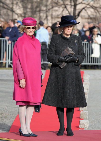 Queen Sonja of Norway talks to Camilla, Duchess of Cornwall talk during a wreath laying at the National Monument at Akershus Fortress on March 20, 2012 in Oslo, Norway.  Prince Charles, Prince of Wales and Camilla, Duchess of Cornwall are on a Diamond Jubilee tour of Scandinavia that takes in Norway, Sweden and Denmark.