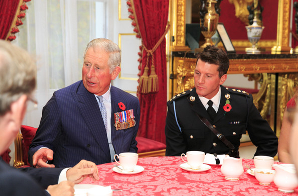 Prince Charles, Prince of Wales hosts an afternoon tea reception for members of the Victoria Cross and George Cross Association at St James Palace on October 27, 2014 in London, England.