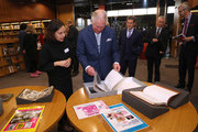 Prince Charles, Prince of Wales looking at archive material of actor Peter Sellers during an official visit to BFI Southbank on December 06, 2018 in London, England.  The Prince of Wales has been Patron of the British Film Institute for 40 years.