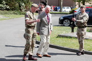 Prince Charles, Prince of Wales walks with Commanding Officer, Lieutenant Colonel Henry Llewelyn-Usher past Quarter guard during a visit to Combermere Barracks on May 5, 2021 in Windsor, England.