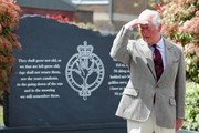 Prince Charles, Prince of Wales gestures next to a memorial during a visit to the Welsh Guards at Combermere Barracks on May 5, 2021 in Windsor, England.