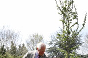 Prince Charles, Prince of Wales helps plant a tree during a visit to the Welsh Guards at Combermere Barracks on May 5, 2021 in Windsor, England.