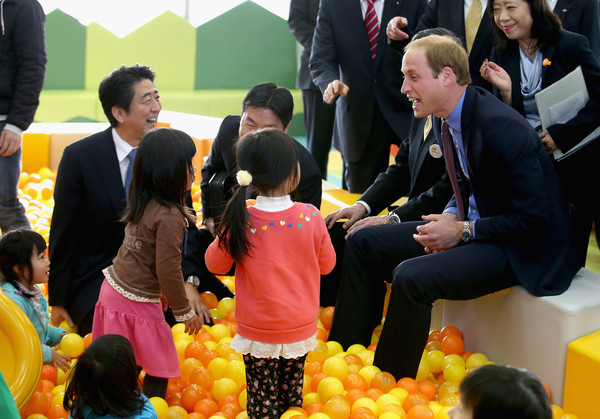 Prince William Prince William, Duke of Cambridge and Japanese Prime Minister Shinzo Abe (blue tie) play with children as they visit Smile Kid's Park on February 28, 2015 in Koriyama, Japan. The Duke of Cambridge is visiting Japan from February 26th to March 1st 2015.