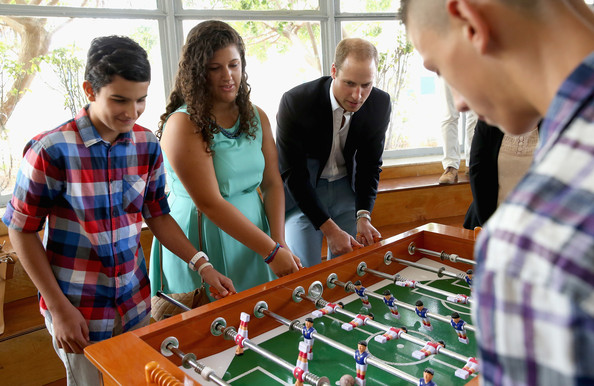 Prince William Prince William, Duke of Cambridge plays table football as he visits an Access Centre for young people called Agenzija Appogg during an official visit to Malta on September 21, 2014 in Valletta, Malta. Prince William, Duke of Cambridge is making an official two day visit to Malta as a representative of Queen Elizabeth II. Originally the Duchess of Cambridge was due to make the trip as her first solo overseas engagement as part of Malta's fiftieth Anniversary of Independance but had to cancel due to acute morning sickness with her second child.