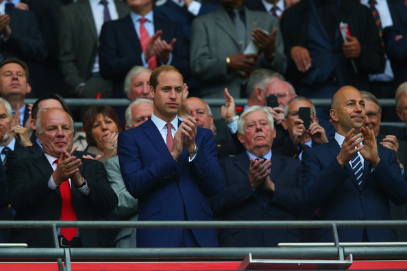 Prince William (L-R)  FA Chairman Greg Dyke, Prince William, Duke of Cambridge and Ivan Gazidis chief executive of Arsenal applaud during the international friendly match between England and Peru at Wembley Stadium on May 30, 2014 in London, England.
