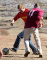 Prince Harry and Prince William play in a football match during a visit to a child education centre on June 16, 2010 in Semonkong, Lesotho. The two Princes are on a joint trip to Africa which takes in Botswana, Lesotho and finally South Africa. During that time they will visit a number of projects supported by their respective charities Sentebale (Prince Harry) and Tusk Trust (Prince William). The trip will culminate with the brothers watching the England vs Algeria World Cup match in Cape Town.
