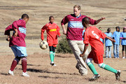 Prince William plays in a football match during a visit to a child education centre on June 17, 2010 in Semonkong, Lesotho. The two Princes are on a joint trip to Africa which takes in Botswana, Lesotho and finally South Africa. During that time they will visit a number of projects supported by their respective charities Sentebale (Prince Harry) and Tusk Trust (Prince William). The trip will culminate with the brothers watching the England vs Algeria World Cup match in Cape Town.