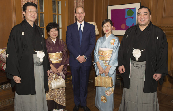 Prince William Sumo champions master Isegehama  Junko, and wife Munkhjargal and the Newly-crowned sumo grand champion Harumafuji meet Prince William, Duke of Cambridge at a reception at the British Embassy, given by the Ambassador, where he met high profile Japanese figures including politicians, artists, young leaders, sportsmen and other leaders in their field on February 27, 2015 in Tokyo, Japan. The Duke of Cambridge is visiting Japan from February 26th to March 1st 2015.