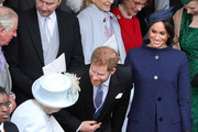 Queen Elizabeth II speaks with the Duke and Duchess of Sussex outside St George's Chapel in Windsor Castle, following the wedding of Princess Eugenie to Jack Brooksbank on October 12, 2018 in Windsor, England.