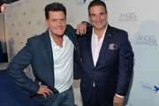 Charlie Sheen and Project Angel Food Executive Director Richard Ayoub attend Project Angel Food's 2018 Angel Awards on August 18, 2018 in Hollywood, California.