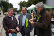 Green Party prospective parliamentary candidate, Larry Sanders (C), who is the brother of former U.S Democrat presidential nominee Bernie Sanders, chats with a local man (L) as he canvasses ahead of the Witney by-election on October 13, 2016 in Witney, England. The seat was vacated by former Prime Minister David Cameron when he stepped down as an MP in September this year, and campaigning has begun by all parties for the now-vacant seat with the by-election due to take place on October 20.