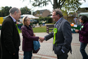 Green Party prospective parliamentary candidate, Larry Sanders (C-R), who is the brother of former U.S Democrat presidential nominee Bernie Sanders, chats with a woman as he canvasses ahead of the Witney by-election on October 13, 2016 in Witney, England. The seat was vacated by former Prime Minister David Cameron when he stepped down as an MP in September this year, and campaigning has begun by all parties for the now-vacant seat with the by-election due to take place on October 20.
