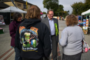 Green Party prospective parliamentary candidate, Larry Sanders (C), who is the brother of former U.S Democrat presidential nominee Bernie Sanders, chats with people as he canvasses ahead of the Witney by-election on October 13, 2016 in Witney, England. The seat was vacated by former Prime Minister David Cameron when he stepped down as an MP in September this year, and campaigning has begun by all parties for the now-vacant seat with the by-election due to take place on October 20.