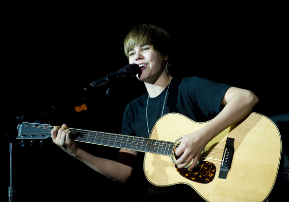 Justin Bieber Justin Bieber performs onstage at the Q102 Jingle Ball at the
