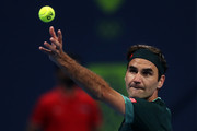 Roger Federer of Switzerland serves in his match against Dan Evans of Great Britain on Day 3 of the Qatar ExxonMobil Open at Khalifa International Tennis and Squash Complex on March 10, 2021 in Doha, Qatar.