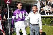 Retiring jockey Richard Hughes and Frankie Dettori on day five of the Qatar Goodwood Festival at Goodwood Racecourse on August 1, 2015 in Chichester, England.