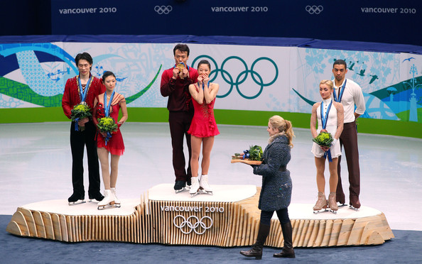 Vancouver 2010 Winter Olympics at the UBC Thunderbird Arena [stage equipment,podium,event,technology,performance,competition,electronic device,recreation,performing arts,heater,figure skating,l-r,silver medal,gold medal,bronze medal,china,jian tong,qing pang,robin szolkowy,aliona savchenko]