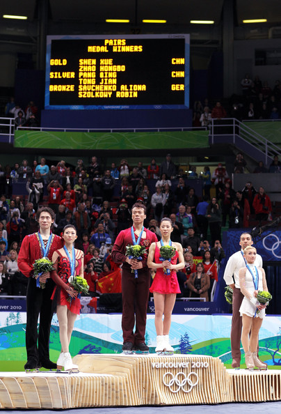 Vancouver 2010 Winter Olympics at the UBC Thunderbird Arena [sports,championship,sport venue,technology,stage equipment,electronic device,individual sports,competition,competition event,games,figure skating,l-r,silver medal,gold medal,bronze medal,china,jian tong,qing pang,robin szolkowy,aliona savchenko]