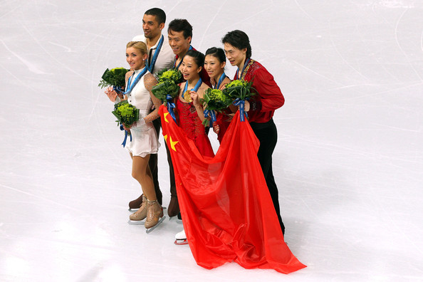 Vancouver 2010 Winter Olympics at the UBC Thunderbird Arena [ice skating,skating,figure skating,recreation,dress,formal wear,event,smile,gown,winter sport,figure skating,l-r,bronze medal,gold medal,silver medal,china,germany,aliona savchenko,robin szolkowy,qing pang]
