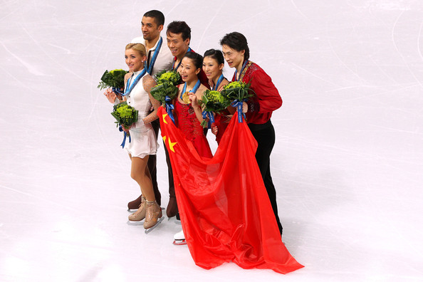 Vancouver 2010 Winter Olympics at the UBC Thunderbird Arena [ice skating,figure skating,skating,recreation,formal wear,event,dress,tradition,ceremony,winter sport,figure skating,l-r,bronze medal,gold medal,silver medal,china,germany,aliona savchenko,robin szolkowy,qing pang]