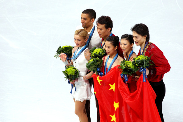 Vancouver 2010 Winter Olympics at the UBC Thunderbird Arena [fun,event,smile,team,figure skating,l-r,bronze medal,gold medal,silver medal,china,germany,aliona savchenko,robin szolkowy,qing pang]