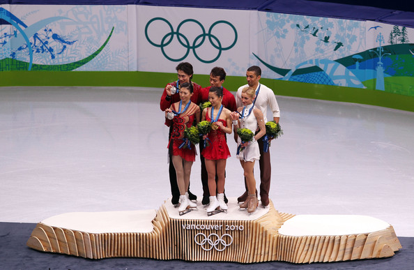 Vancouver 2010 Winter Olympics at the UBC Thunderbird Arena [competition,recreation,footwear,skating,figurine,world,competition event,figure skating,l-r,silver medal,gold medal,bronze medal,china,jian tong,qing pang,robin szolkowy,aliona savchenko]