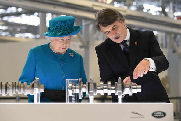 Queen Elizabeth II is shown engine parts by chief executive Dr Ralf Speth (R) during a tour of the  new Jaguar Land Rover Engine Manufacturing Centre in Wolverhampton on October 30, 2014 in Wolverhampton.