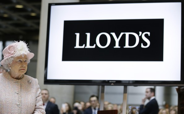 Queen Elizabeth II visits the Lloyds of London building on March 27, 2014 in London, England.