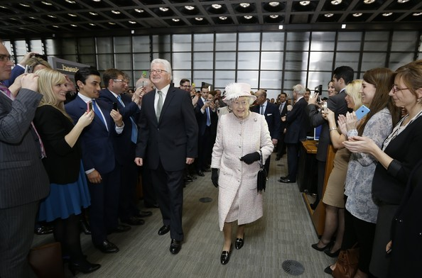 Queen Elizabeth II is escorted by Lloyd's Chairman John Frederick Nelson as she visits the Lloyds of London building on March 27, 2014 in London, England.