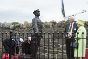 Queen Elizabeth II & Prince Philip, Duke Of Edinburgh attend the unveiling of the Robert Quigg VC memorial statue in Bushmills village on June 28, 2016 in Bushmills, Northern Ireland.