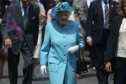 Britain's Queen Elizabeth II arrives at Mayflower Primary School during a visit to Poplar in Tower Hamlets in East London on June 15, 2017, as part of commemorations to mark the centenary of the bombing of Upper North Street School during the First World War..Mayflower Primary School now exists on the site of the Upper North Street School. / AFP PHOTO / POOL / Daniel LEAL-OLIVAS