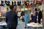 Britain's Queen Elizabeth II (C) and Britain's Prince Philip, Duke of Edinburgh (R) are shown around Mayflower Primary School during a visit to Poplar in Tower Hamlets in East London on June 15, 2017, as part of commemorations to mark the centenary of the bombing of Upper North Street School during the First World War..Mayflower Primary School now exists on the site of the Upper North Street School. / AFP PHOTO / POOL / Daniel LEAL-OLIVAS