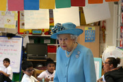 Britain's Queen Elizabeth II is shown around Mayflower Primary School during a visit to Poplar in Tower Hamlets in East London on June 15, 2017, as part of commemorations to mark the centenary of the bombing of Upper North Street School during the First World War..Mayflower Primary School now exists on the site of the Upper North Street School. / AFP PHOTO / POOL / Daniel LEAL-OLIVAS