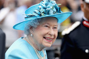 Queen Elizabeth II leaves Mayflower Primary School during an official visit to Tower Hamlets on June 15, 2017 in London, England.  The visit coincides with commemorations for the centenary of the bombing of Upper North Street School during the First World War.