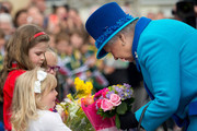 Queen Elizabeth II accepts flowers during an official visit to Cotts Farm Equine Hospital, Narbeth on April 29, 2014 in Narbeth, Wales. The Cotts Equine Hospital is a purpose-built facility offering veterinary equine care.