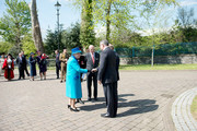 Queen Elizabeth II accompanied by Prince Philip, The Duke of Edinburgh, arrive at the Royal Dockyard Chapel during an official visit on April 29, 2014 in Pembroke Dock, United Kingdom. This year sees the 200th anniversary of the town of Pembroke Dock. The Royal Dockyard Chapel has undergone a restoration project to become the base for Pembroke Dock's Heritage Centre which celebrates 200 years of a unique naval and military community.