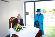 Queen Elizabeth II and Prince Philip, The Duke of Edinburgh, sign the Royal Dockyard Chapel's visitors book during an official visit on April 29, 2014 in Pembroke Dock, United Kingdom. This year sees the 200th anniversary of the town of Pembroke Dock. The Royal Dockyard Chapel has undergone a restoration project to become the base for Pembroke Dock's Heritage Centre which celebrates 200 years of a unique naval and military community.