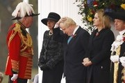 (L-R) British Prime Minister Theresa May, Foreign Secretary Boris Johnson and Home Secretary Amber Rudd take part in a ceremonial welcome for Colombia's President Juan Manuel Santos and his wife Maria Clemencia de Santos at Horse Guards Parade on November 1, 2016 in London, England. The President is on a state visit to Britain.