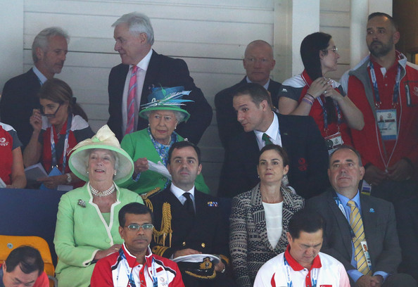 Queen Elizabeth II HRH Queen Elizabeth II watches the heats with First Minister of Scotland Alex Salmond (bottom R) at the Tollcross International Swimming Centre during day one of the Glasgow 2014 Commonwealth Games on July 24, 2014 in Glasgow, Scotland.