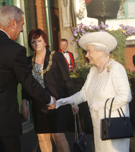 Queen Elizabeth II Queen Elizabeth II is greeted by Lord Smith of Kelvin Chairman of Glasgow 2014 as she arrives at the opening ceremony of the Glasgow 2014 Commonwealth Games at Celtic Park on July 23, 2014 in Glasgow, Scotland.