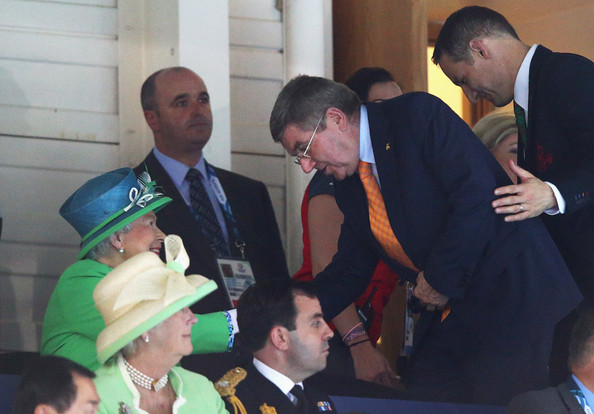 Queen Elizabeth II HRH Queen Elizabeth II is greeted by IOC President Thomas Bach as they watch the heats at the Tollcross International Swimming Centre during day one of the Glasgow 2014 Commonwealth Games on July 24, 2014 in Glasgow, Scotland.