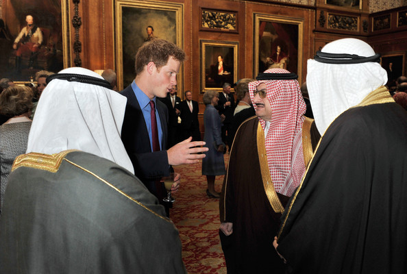 Prince Harry talks to Prince Al Saud of Saudi Arabia during a reception in the Waterloo Chamber, before her Sovereign Monarch's Jubilee lunch, at Windsor Castle, on May 18, 2012 in Windsor, England.