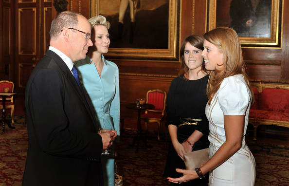 Princess Eugenie and Princess Beatrice  talk to Princess Charlene of Monaco and Prince Albert II of Monaco during a reception in the Waterloo Chamber, before the Lunch For Sovereign Monarchs at Windsor Castle, on May 18, 2012 in Windsor, England.