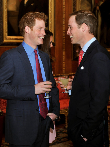 Prince William, Duke of Cambridge speaks to Prince Harry during a reception in the Waterloo Chamber, before the Lunch For Sovereign Monarchs at Windsor Castle, on May 18, 2012 in Windsor, England.